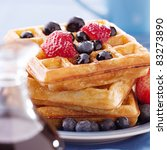 breakfast : waffles with blueberries and strawberries - stock photo