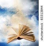 flying opened magic book | Shutterstock . vector #83313844