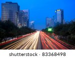 light trails on the street at dusk in beijing,China - stock photo