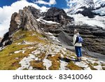 old woman contemplating eiger... | Shutterstock . vector #83410060