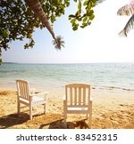 tropical sunset on beach - stock photo
