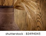 old crock with a bunch of wheat ... | Shutterstock . vector #83494045