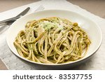 Small photo of African basil pesto with whole wheat fettuccini, with the juice of fresh tomatoes added after. Parmesan to flavor. Yum!