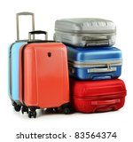 Luggage consisting of five polycarbonate suitcases isolated on white - stock photo