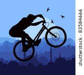 Mountain bike trial rider in arabic city landscape illustration - stock vector