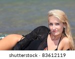 attractive girl posing on the... | Shutterstock . vector #83612119