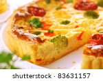 cheese quiche with broccoli, cauliflower, carrots and tomatoes - stock photo
