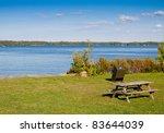 Picnic table at a lake - stock photo