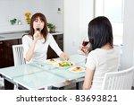 attractive asian women eating   Shutterstock . vector #83693821