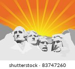Mount Rushmore in the background of orange light