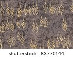 a wall display of ear rings. | Shutterstock . vector #83770144
