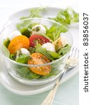 Fresh salad with vegetables and mozarella. Selective  focus - stock photo