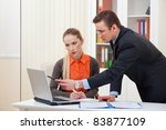 manager man and young businesswoman in the office - stock photo