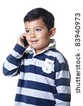 A young boy talks on the cellphone. - stock photo