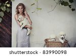 Young beauty and puppies in basket - stock photo