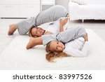 Girls living healthy life doing gymnastic exercises at home - stock photo