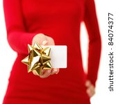 Gift card - closeup of woman showing sign card wearing red. Isolated on white background. - stock photo