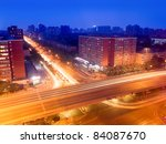 traffic junction and viaduct at dusk - stock photo
