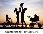 silhouettes of happy parents... | Shutterstock . vector #84089224