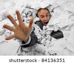 Businessman Sinking In Heap Of...