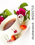 rosehip tea on the background of fruits and flowers - stock photo