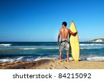 surfer holding a surf board on... | Shutterstock . vector #84215092