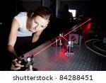 female scientist doing research in a quantum optics lab