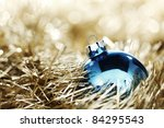 blue christmas ball on golden background - stock photo