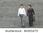 two asian business men walking... | Shutterstock . vector #84301675