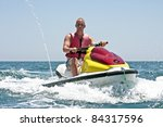 Young guy on a jet ski on the atlantic ocean - stock photo
