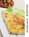 closeup of a typical spanish tortilla de patatas and a bowl with olives - stock photo