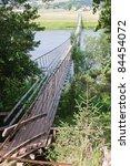 suspended bridge across the... | Shutterstock . vector #84454072