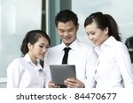 Asian  Business people using a Digital Tablet - stock photo