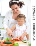 mother and daughter in kitchen... | Shutterstock . vector #84496237
