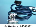 stethoscope on blue background | Shutterstock . vector #84541312