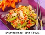oriental dinner with deep fried chicken,vegetables and noodles - stock photo