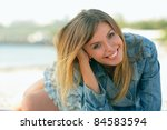 portrait of a blond woman at... | Shutterstock . vector #84583594