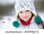 Winter portrait of adorable happy child girl in warm clothes - stock photo