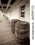 Antique/Vintage Wine Barrels in a long walkway at Fort Frederick, MD - stock photo