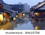Night scene of traditional building near the river in Wuzhen town, Zhejiang province, China - stock photo