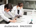 serious science students using... | Shutterstock . vector #84631033