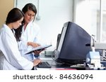 female scientists comparing... | Shutterstock . vector #84636094