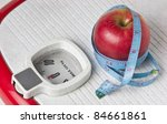 apple and measuring tape on the