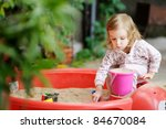 adorable little girl playing in ...