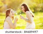 two young girls playing with... | Shutterstock . vector #84689497
