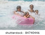 family in the waves - stock photo