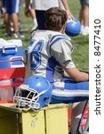 Youth Football Player On Bench