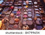 FEZ, MOROCCO - DEC 22: Unidentified workers processing hides in colorful tanning pools at a traditional leather tannery,  December 22, 2009 Fez, Morocco. - stock photo