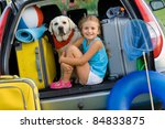 Vacation, Travel - Girl with dog ready for the travel for summer vacation - stock photo