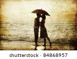 Couple Kissing Under Umbrella...